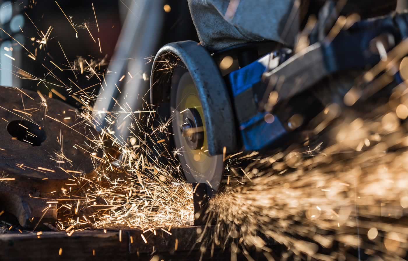 Close up metal cutting creating sparks